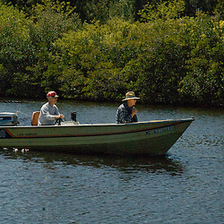 man and woman, couple in motor boat in florida