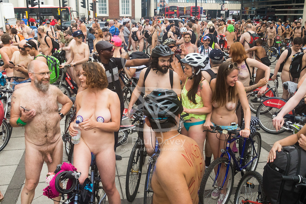 Westminster Bridge, London, June 11th 2016. Hundreds of naked and semi-naked cyclists participate in the World Naked Bike Ride that takes place in cities around the world, to highlight the alternatives to hydrocarbon fuels. PICTURED: Naked cyclists take a breather after crossing Westminster Bridge.