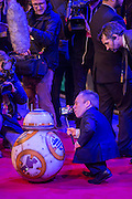 Warwick Davis meets one of the robots -  The European Premiere of STAR WARS: THE FORCE AWAKENS - Odeon, Empire and Vue Cinemas, Leicester Square, London.