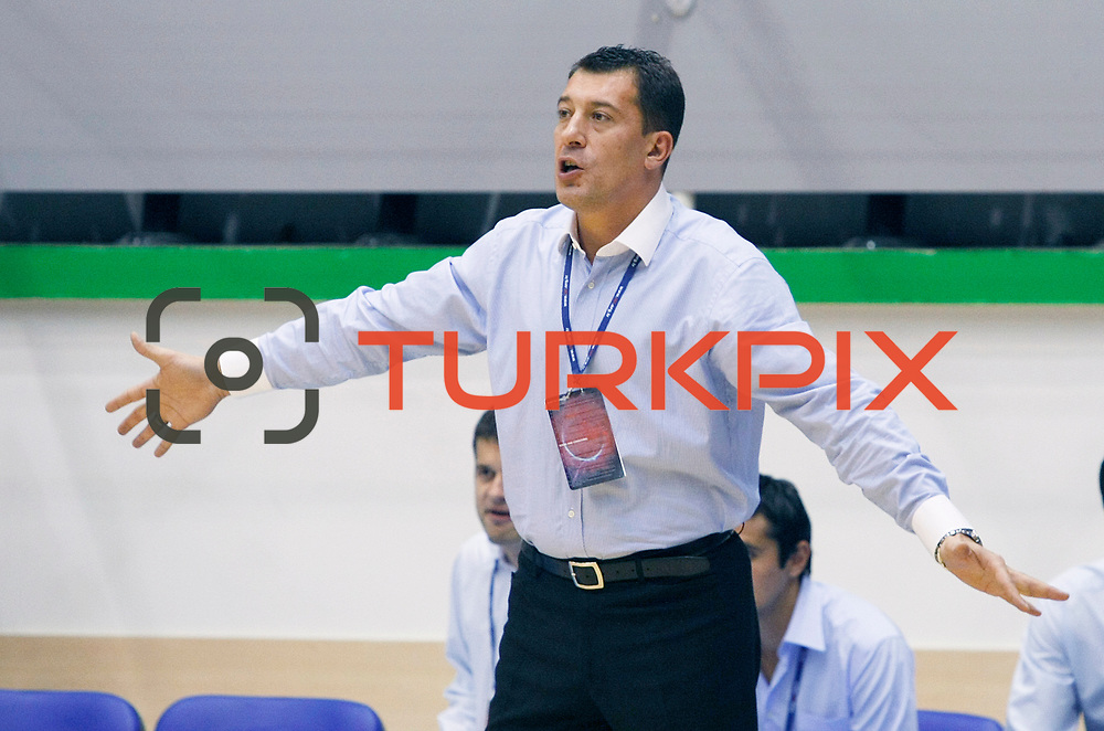 Anadolu Efes's coach Ufuk SARICA during their Turkey Cup Qualifying basketball second match Anadolu Efes between Pinar Karsiyaka at Aliaga Arena in Izmir, Turkey, Monday, October 10, 2011. Photo by TURKPIX