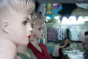 Female Western looking showroom dummies at a textiles shop in downtown Shanghai, China. This style of western dummy with sculpted hair, bright red lips and dark eye make up is common throughout the city, and can be seen all over China. This choice of western model interestingly reflects the desire for western looks and light skin common amongst Chinese women in particular.