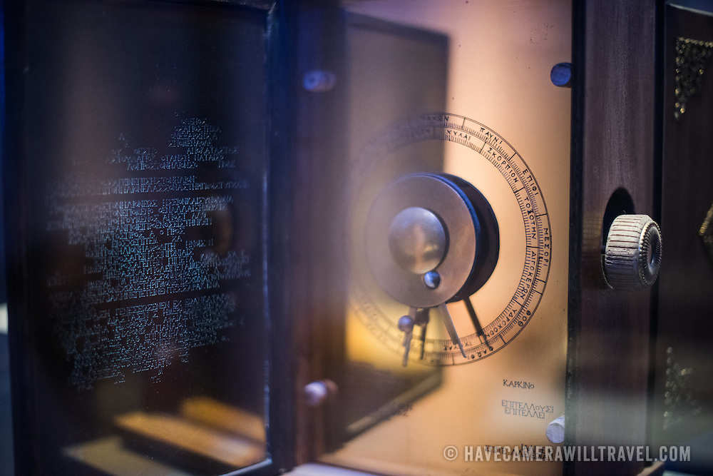 A 2011 reconstruction of the Antikythera Mechanism designed and constructed by the Aristotle University of Thessaloniki. One of the highlights of the National Archaeological Museum in Athens, Greece, the Antikythera Mechanism now has its own dedicated exhibit gallery in which all of its fragments are on display. Believed to date to somewhere around 100 BC to 205 BC, it was found amongst a large cache of statues, coins, and other artefacts on a sunken shipwreck discovered in 1900 by sponge divers off the coast of the Greek island of Antikythera. It was badly damaged after such a long time in the salt water, but extensive research in recent decades has resulted in a consensus that it is a kind of astronomical analog computer as well as some modern reconstructions.