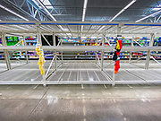 """15 MARCH 2020 - ANKENY, IOWA: The empty toilet paper aisle at the Walmart store in Ankeny. Iowans started hoarding paper products and canned goods over the weekend as fears of coronavirus caused shortages spread. The Governor of Iowa announced Saturday night that the Coronavirus in Iowa had entered the """"community spread"""" phase when a person in Dallas County, in the Des Moines metropolitan area, tested positive for Coronavirus. As of Sunday morning, Iowa was reporting 18 people tested positive for Coronavirus.   PHOTO BY JACK KURTZ"""
