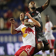 Jermain Defoe, (right), Toronto FC and Eric Alexander, New York Red Bulls, challenge for the ball during the New York Red Bulls Vs Toronto FC, Major League Soccer regular season match at Red Bull Arena, Harrison, New Jersey. USA. 11th October 2014. Photo Tim Clayton