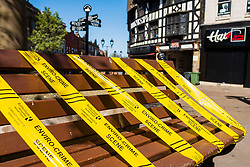 20 April 2020 Rotherham South Yorkshire - Week 5 of the UK emergency measures to combat the Coronavirus Covid-19 Pandemic. Rotherham Council emprises the message that people should not be sitting around in public spaces by taping off public benches in  All Saint Square<br /> <br /> 20 April 2020<br /> <br /> www.pauldaviddrabble.co.uk<br /> All Images Copyright Paul David Drabble - <br /> All rights Reserved - <br /> Moral Rights Asserted -