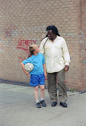 Boy and carer walking together and talking,