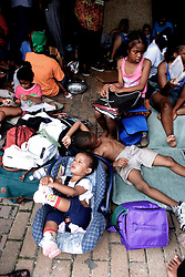 31st August, 2005. 'Hell on earth.' The Superdome in New Orleans, Louisiana where over 20,000 refugees from hurricane Katrina are crammed into hellish conditions. Children sprawled out in the baking sun amidst the masses at the Superdome.