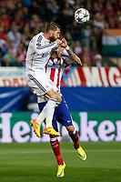 Atletico de Madrid's Mandzukic (R) and Real Madrid´s Sergio Ramos during quarterfinal first leg Champions League soccer match at Vicente Calderon stadium in Madrid, Spain. April 14, 2015. (ALTERPHOTOS/Victor Blanco)