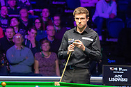 Action from the World Snooker 19.com Scottish Open Final Mark Selby vs Jack Lisowski at the Emirates Arena, Glasgow, Scotland on 15 December 2019.<br /> <br /> Jack Lisowski at the table pondering his next move.