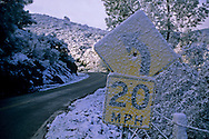 Rare low-altitude snowfall causes concerns for drivers on Mines Road, Alameda County, CALIFORNIA