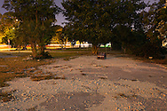 An abandoned toy car sits in a vacant lot at night. WATERMARKS WILL NOT APPEAR ON PRINTS OR LICENSED IMAGES.