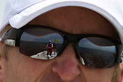View of Peter Gilmour reflected in Cameron Dunn's sunglasses. Portimao Portugal Match Cup 2010. World Match Racing Tour. Portimao, Portugal. 25 June 2010. Photo: Gareth Cooke/Subzero Images