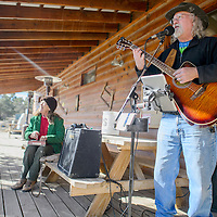 Wayne Ramm performs on the porch of the Candy Kitchen Trading Post during a winter solstice celebration in Candy Kitchen Saturday.