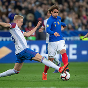 PARIS, FRANCE - March 25:  Antoine Griezmann #7 of France is challenged by Hordur Bjorgvin Magnusson #18 of Iceland during the France V Iceland, 2020 European Championship Qualifying, Group Stage at  Stade de France on March 25th 2019 in Paris, France (Photo by Tim Clayton/Corbis via Getty Images)