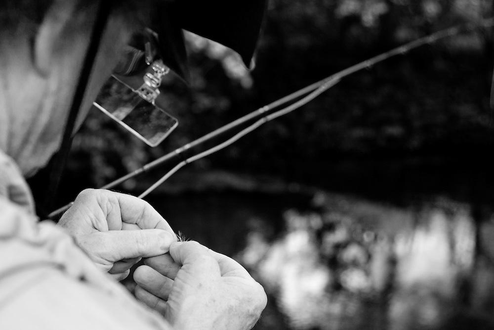 Streamside tying on a new fly.  Magnifier.  Zanesfield Rod & Gun Club, Zanesfield, OH, Don Dean Biochemistry Professor at Ohio State University, OSU