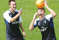 Chelsea's John Terry (left) and Frank Lampard with their mobile phones during a training session at their training ground in Harlington, London, where Orange and Chelsea FC announced their three-year partnership deal.  THIS PICTURE CAN ONLY BE USED WITHIN THE CONTEXT OF AN EDITORIAL FEATURE. NO WEBSITE/INTERNET USE UNLESS SITE IS REGISTERED WITH FOOTBALL ASSOCIATION PREMIER LEAGUE.