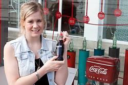 © Licensed to London News Pictures.  20/05/2011. London, UK. Melanie Jack, 25, from Hackney with a classic glass coke bottle. Coca-Cola launches a free installation at the Design Museum Tank  showcasing a selection of the brand's memorable past designs, marking its 125th anniversary. See special instructions for rates. Photo credit should read Bettina Strenske/LNP