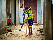 07 OCTOBER 2017 - MORATUWA, SRI LANKA: Children play a pickup game of cricket in Moratuwa, a fishing village south of Colombo. Fish is an important source for many Sri Lankans. Sri Lankans are obsessed by cricket.  PHOTO BY JACK KURTZ