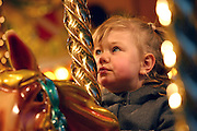 A little girl enjoying a turn on a carousel in Covent Garden Plaza, on Thursday, Dec. 23, 2004.  **ITALY OUT**