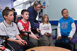Children playing on a video game at Greenlane Youth Centre; Nottingham,