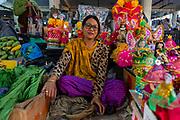 Woman vendor selling colourful dolls, Ima Keithel women´s market, Imphal, Manipur, India