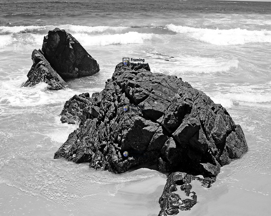 There's something about the use of black and white imagery that is very rewarding. I have taken the calm and relaxing image of the stunning beach at Byron Bay and through black and white you some how get a much deeper and stronger image. Here the waves break on rocks on the edge of the main beach as the pacific ocean meets Australia. Here I shot with a high shutter speed to catch the waves in motion as they broke so dramatically on the rocks before me. <br /> <br /> This image is available as a personal use or commercial use downloads and selected images are available to order as framed, unframed or canvas photo art prints. All of our photo art prints are limited editions, we will only make available 50 prints of each image, ensuring you have an exclusive peace of highly collectable photo art to add to any home or business.