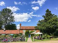 Pub in Itterham Norfolk on a warm summers day