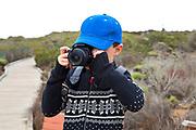 Young boy taking photos with a camera, Elfin Forest, Baywood Park, San Luis Obispos County, California, USA (MR)