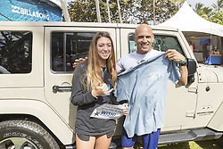 December 11, 2017 - Haleiwa, Hawaii, U.S. - 11X World Champion Kelly Slater of the USA happily grants a wish by meeting Gal from Make A Wish Foundation who wanted to meet the 11X World Champion and wish him well at the 2017 Billabong Pipe Masters at Pipe, Hawaii, USA...Billabong Pipe Masters 2017. (WSL via ZUMA Wire/ZUMAPRESS.com)
