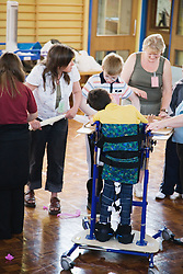 Child with cerebral palsy in standing frame,