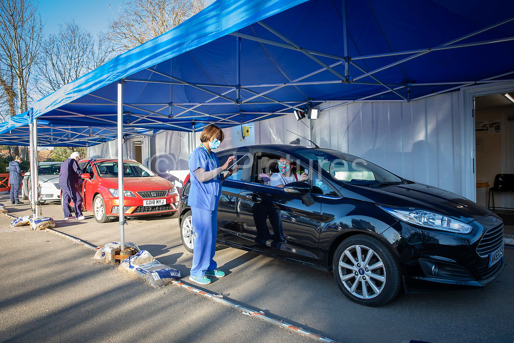 Nurses assessing Folkestone residents at a drive through medical centre about to receive their first dose of the COVID-19 AstraZeneca Oxford vaccine in the car park of Folkestone council offices on Saturday the 27th of February 2021, Folkestone, Kent, United Kingdom.