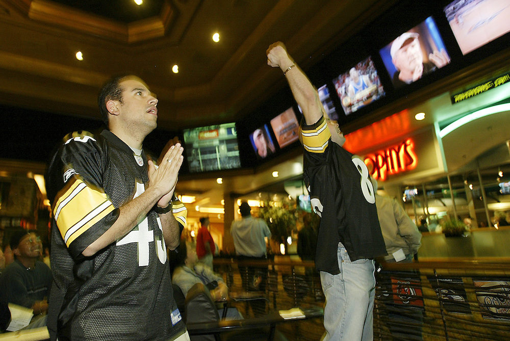 Pittsburgh Steeler fans cheer the final action in the sports book inside the Green Valley Ranch Resort and Spa as their team overcomes the New York Jets in overtime. Sports Illustrated rated the sports book, complete with oversize, leather chairs, as one of the top places in the country to watch sports.