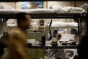 Inmates are crowded into gymnasiums coverted into dormitories at the California State Prison Ð Sacramento in Folsom, California, Thursday, Dec. 7, 2006. The California prison system is so crowded that 16,000 inmates are assigned cots in hallways and gyms Ð leading Gov. Arnold Schwarzenegger to declare a state of emergency for the system.