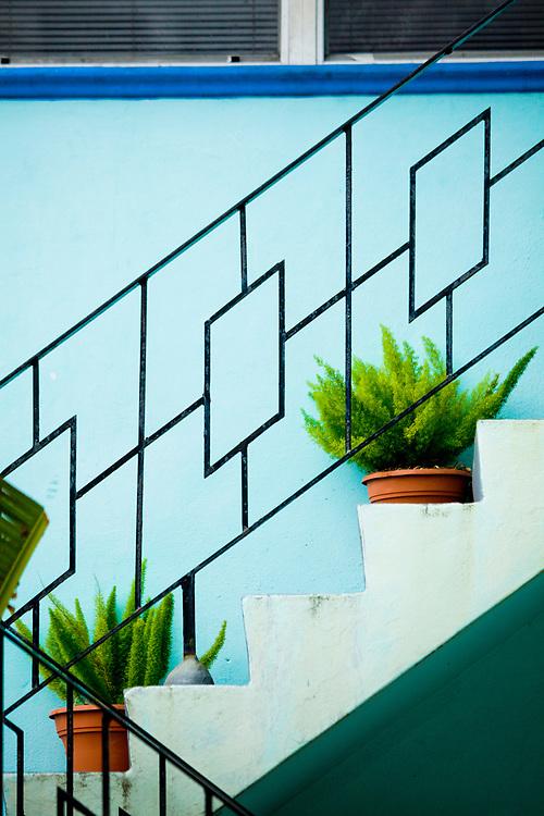 A Miami Modern stair railing on a small apartment building in Miami Beach