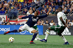 September 1, 2018 - Foxborough, MA, U.S. - FOXBOROUGH, MA - SEPTEMBER 01: New England Revolution midfielder Teal Bunbury (10) tries a shot as Portland Timbers goalkeeper Wade Hamilton (33) defends during a match between the New England Revolution and the Portland Timbers on September 1, 2018, at Gillette Stadium in Foxborough, Massachusetts. The teams played to a 1-1 draw.(Photo by Fred Kfoury III/Icon Sportswire) (Credit Image: © Fred Kfoury Iii/Icon SMI via ZUMA Press)