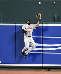 September 19, 2017 - Baltimore, MD, USA - Boston Red Sox center fielder Jackie Bradley times his jump perfectly to rob a potential home run from the Baltimore Orioles' Chris Davis in the fifth inning at Oriole Park at Camden Yards in Baltimore on Tuesday, Sept. 19, 2017. The Red Sox won, 1-0, in 11 innings. (Credit Image: © Kenneth K. Lam/TNS via ZUMA Wire)