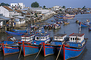 Fleet of blue and red painted fishing boats, Nha Trang, Vietnam