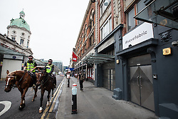 © Licensed to London News Pictures. 07/09/2016. London, UK. Two mounted police officers ride past London's world famous Fabric nightclub on Charterhouse Street. Islington Council revoked the club's license on 6 September 2016 following the drug-related deaths of two 18-year-old men. The decision has drawn condemnation from across the music community. Photo credit: Rob Pinney/LNP