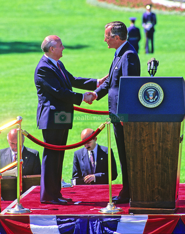 United States President George H.W. Bush, right, shakes hands with President Mikhail Gorbachev of the Union of Soviet Socialist Republics, left, during a state arrival ceremony on the South Lawn of the White House in Washington, DC on Thursday, May 31, 1990. It was the start of three days of talks between the two leaders. Photo by Ron Sachs / CNP /ABACAPRESS.COM