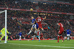 10th December 2017 - Premier League - Liverpool v Everton - Jonjoe Kenny of Everton heads clear from Dominic Solanke of Liverpool - Photo: Simon Stacpoole / Offside.