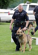 Middletown, New York - A police officer watches his police dog during a demonstration at the festival following the 15th annual Ruthie Dino Marshall 5K Run and Fun Walk hosted by the Middletown YMCA on Sunday, June 5, 2011.