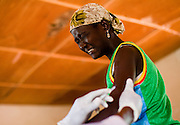 A young woman grimaces as she receives meningitis vaccine at a MSF vaccination site in Tibiri, Niger on Friday April 17, 2009..