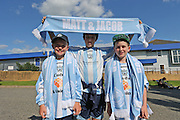 Young fans with Matt and Jacob tribute scarves before the FA Vase 1st Qualifying Round match between Worthing United and East Preston FC at the Robert Eaton Memorial Ground, Worthing, United Kingdom on 6 September 2015. The first home match for Worthing United since losing team mates Matthew Grimstone and Jacob Schilt in the Shoreham air show disaster.