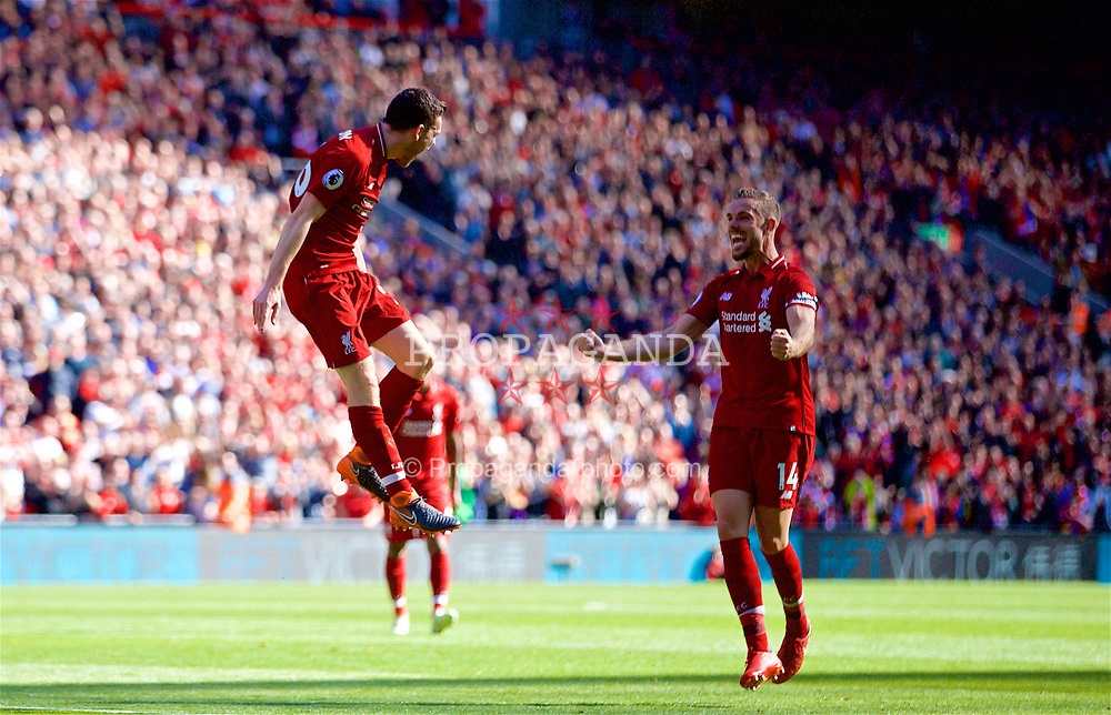LIVERPOOL, ENGLAND - Sunday, May 13, 2018: Liverpool's Andy Robertson celebrates scoring the fourth goal, his first for the club, with team-mate captain Jordan Henderson during the FA Premier League match between Liverpool FC and Brighton & Hove Albion FC at Anfield. Liverpool won 4-0 and finished the season 4th. (Pic by David Rawcliffe/Propaganda)