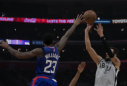 November 15, 2018 - Los Angeles, California, U.S - Lou Williams #23 of the Los Angeles Clippers tries to block Marco Belinelli #18 of the San Antonio Spurs during their NBA game on Thursday November 15, 2018 at the Staples Center in Los Angeles, California. Clippers defeat Spurs, 116-111. (Credit Image: © Prensa Internacional via ZUMA Wire)