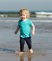 © Licensed to London News Pictures. 28/03/2012..Saltburn, England..As temperatures rise this week the beach at Saltburn in Cleveland attracts the visitors as they enjoy the warm weather. Hannah Cuthbert, 18 months from Stockton enjoys a splash at the waters edge...Photo credit : Ian Forsyth/LNP