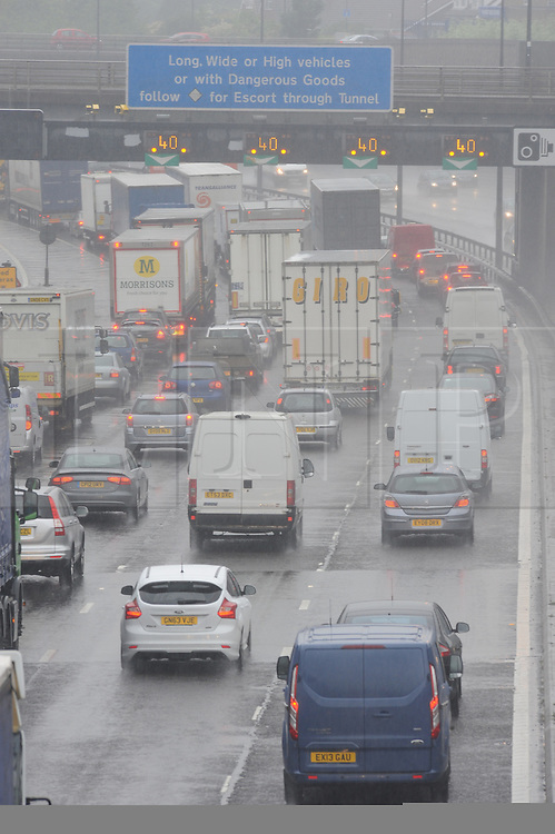 © Licensed to London News Pictures. 27/05/2014<br /> More May Rain today (27.05.2014)<br /> Heavy rain this afternoon is causing chaos on the M25 anti-clockwise towards  QE2 Bridge the Dartford Crossing with speed  restrictions of 40mph in place due to the bad weather traffic is at a virtual standstill.<br /> Photo credit :Grant Falvey/LNP