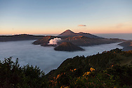 Bromo-Tengger-Semeru National Park in eastern Java. The park has three volcanoes and a large sandy caldera. Mt. Bromo is the most active of the three and consistently puffs steam and ash.