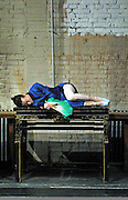 "A Chinese ballerina catches a quick nap after a rehearsal for ""Raise The Red Lantern"" August 6, in Beijing. The ballet, based on a film with the same named is directed by Zhang Yimou, tells the story of a young woman who becomes one of four wives of a wealthy Chinese man in the 1920s and faces violent family intrigue. The 1991 film, based on Su Tong's novel, helped to make Zhang and actress Gong Li stars abroad and attract world attention to China's film industry. The ballet was first performed in 2001."