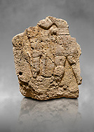 Hittite relief sculpted orthostat stone panel of Long Wall Limestone, Karkamıs, (Kargamıs), Carchemish (Karkemish), 900 - 700 B.C. Anatolian Civilisations Museum, Ankara, Turkey. The short-skirted figure with a dagger at the waist holds the gazelle from its hind legs.<br /> <br /> On a grey art background. .<br />  <br /> If you prefer to buy from our ALAMY STOCK LIBRARY page at https://www.alamy.com/portfolio/paul-williams-funkystock/hittite-art-antiquities.html  - Type  Karkamıs in LOWER SEARCH WITHIN GALLERY box. Refine search by adding background colour, place, museum etc.<br /> <br /> Visit our HITTITE PHOTO COLLECTIONS for more photos to download or buy as wall art prints https://funkystock.photoshelter.com/gallery-collection/The-Hittites-Art-Artefacts-Antiquities-Historic-Sites-Pictures-Images-of/C0000NUBSMhSc3Oo